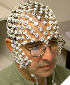 Photo of Dr. Tucker wearing a dense EEG net.